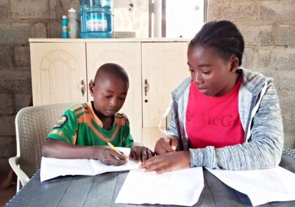 Mercy tutoring one of the children